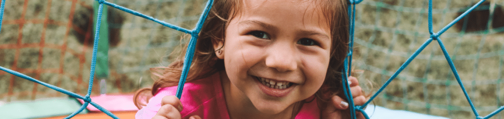 Child Smiling in a playground